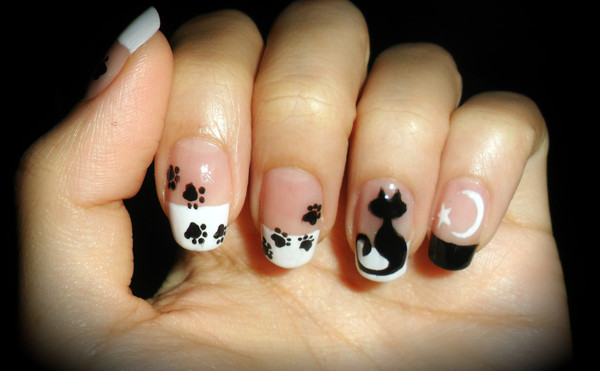 A nice white tail, moon-star combination and several paws –that could be  all you need to turn your manicure routine into an enchanting black cat  nail art ... - 50 Classic Black And White Nail Art Designs
