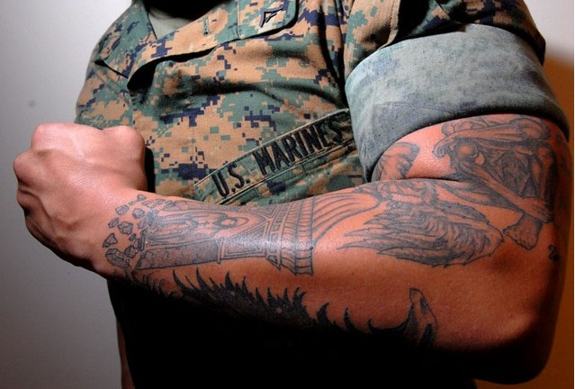 "Lance Cpl. Tom Blachard shows his tattoo ""sleeves"" that cover one of his arms. There is a new push by Sgt. Majors to make these type of tattoos against Marine regulations. (Photo by Alan Lessig/Marine Corps Times)"