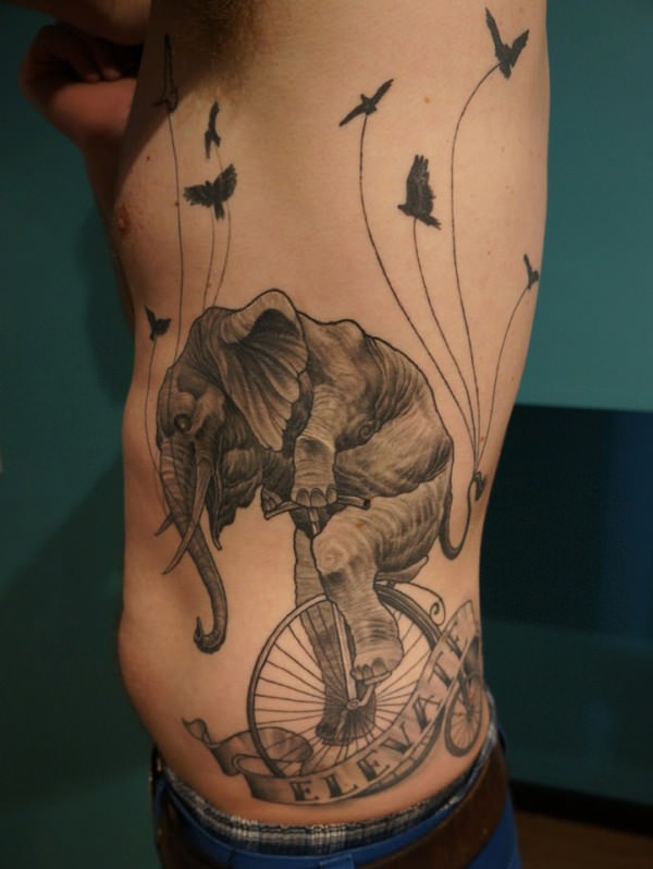 elephant tattoo trunk up meaning