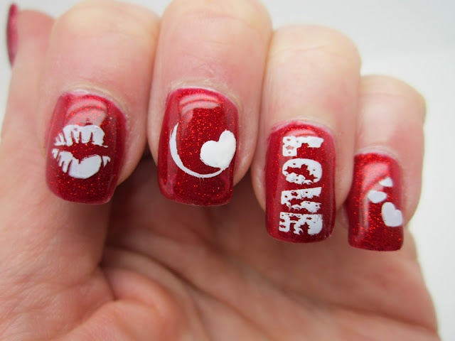 Another Childishly Easy Design With White Nail Lacquer And Rhinestones On Classically Red Painted Nails Except For The Middle Finger