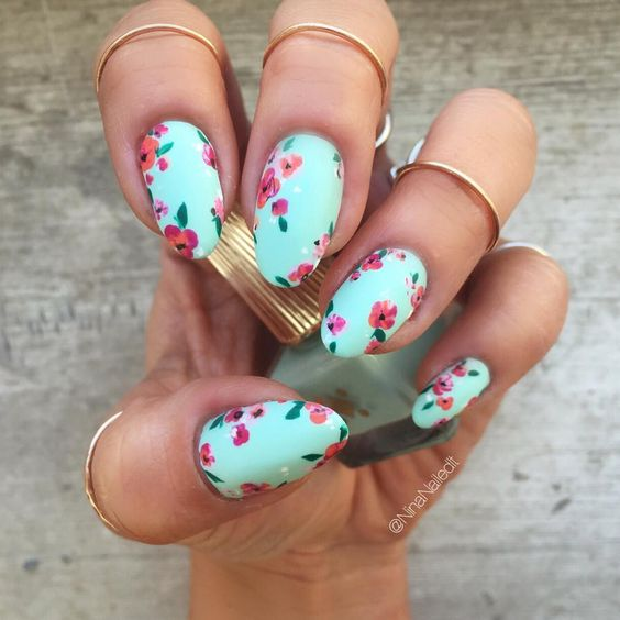 Among the most widespread mint nail art ideas are the floral designs,  geometric patterns and nautical style. - Mint Green Nails For Pretty Ladies